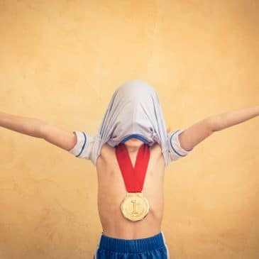 little boy winner with medal