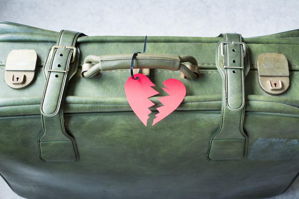 suitcase broken heart breakup concept