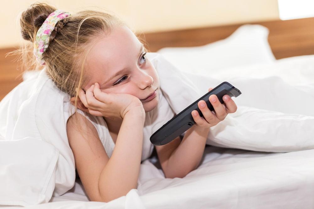 little girl bored tv