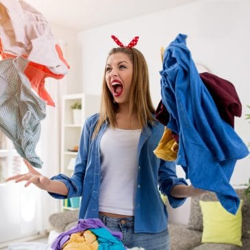 woman with laundry angry