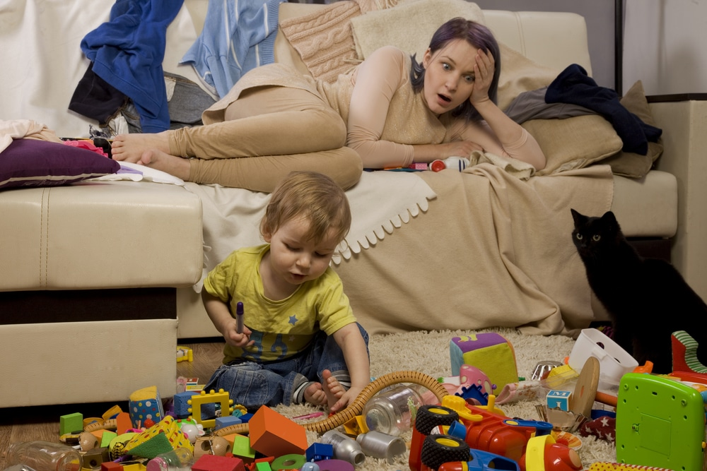 woman lying on couch watching kid