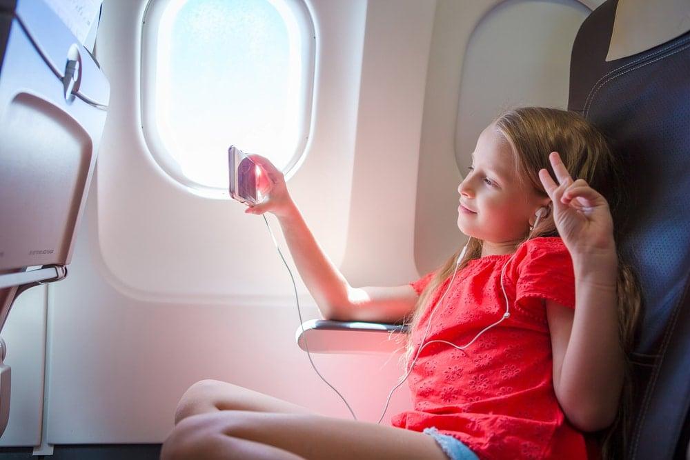 girl travel airplane
