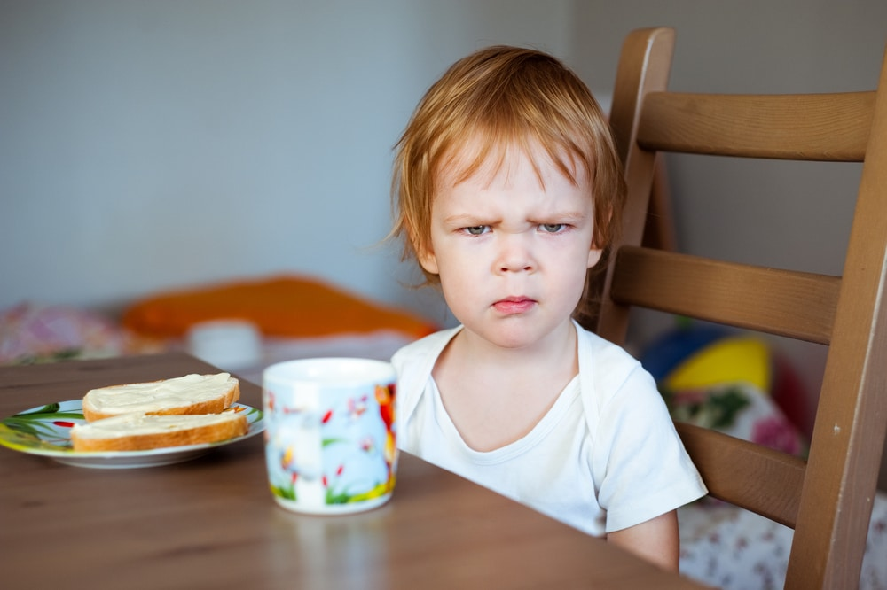 kid angry at breakfast