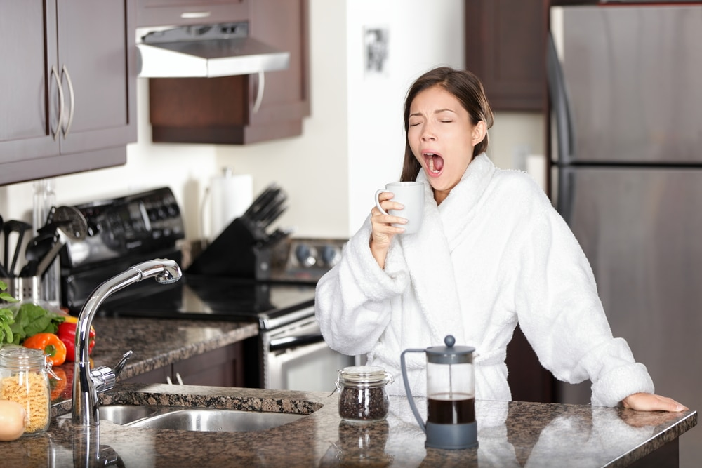 tired woman in kitchen