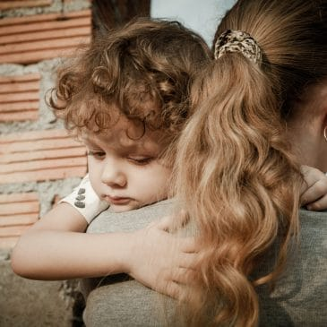 mother embrace kid