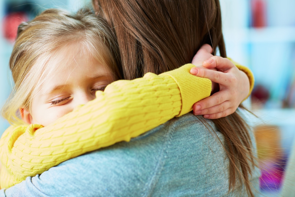 girl embrace mother