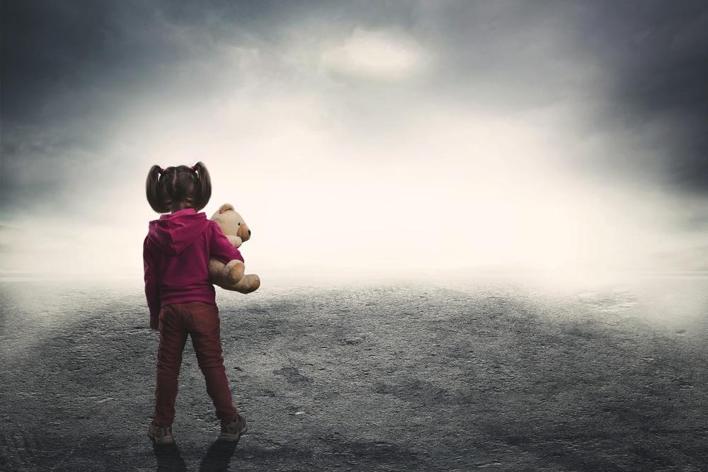 little girl in the dark