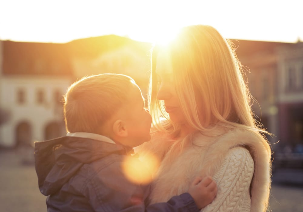 boy and mother in the sun