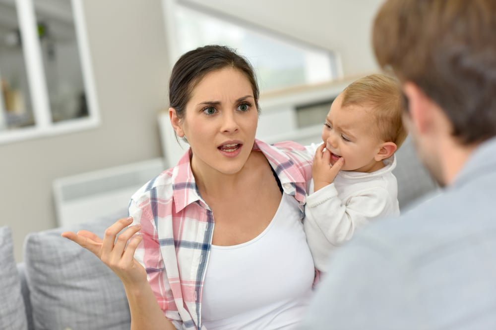 unhappy mother with father