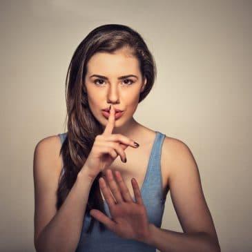 be quiet gesture woman
