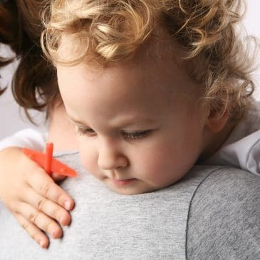 kid embrace mother