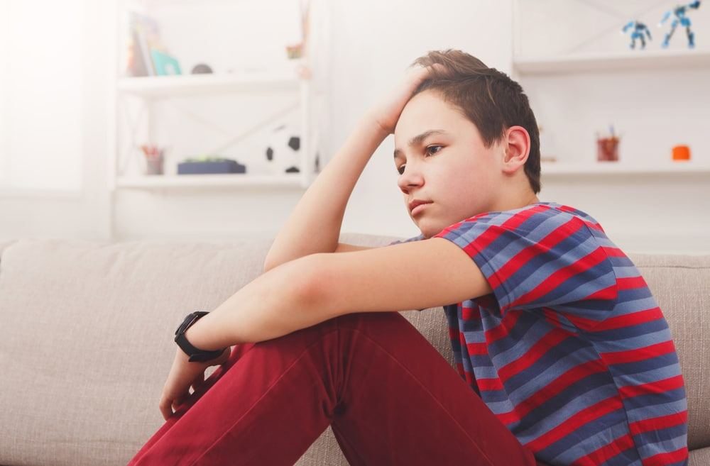 teenager boy pensive