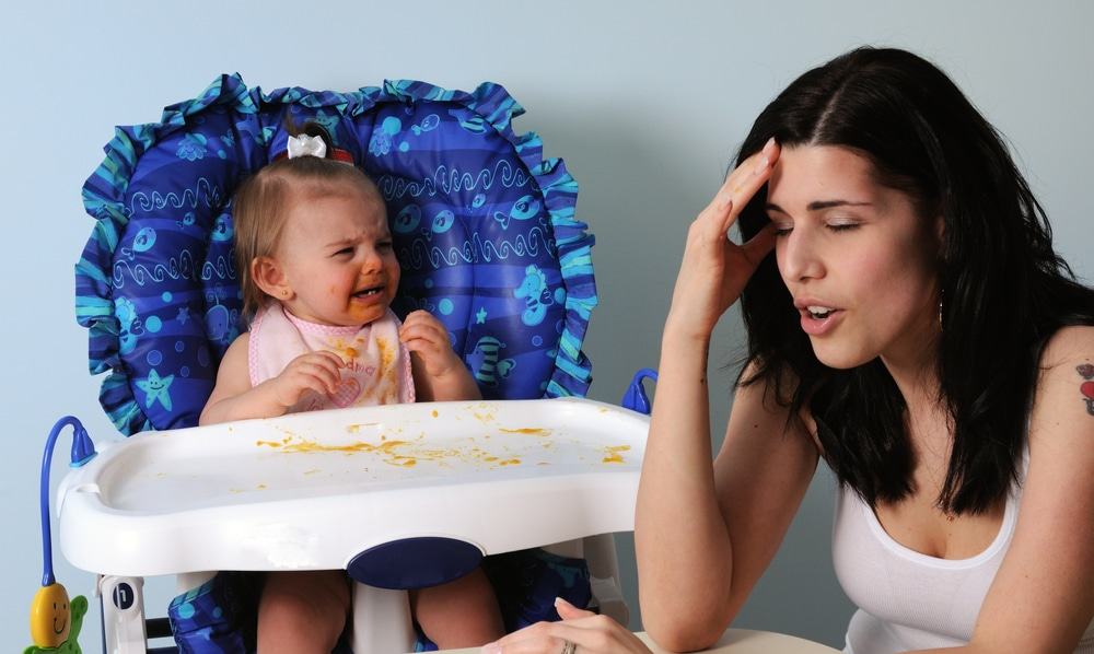 tired mother with baby eating