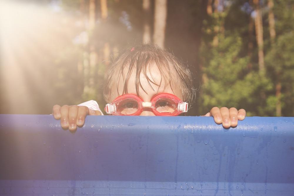 little kid in a pool