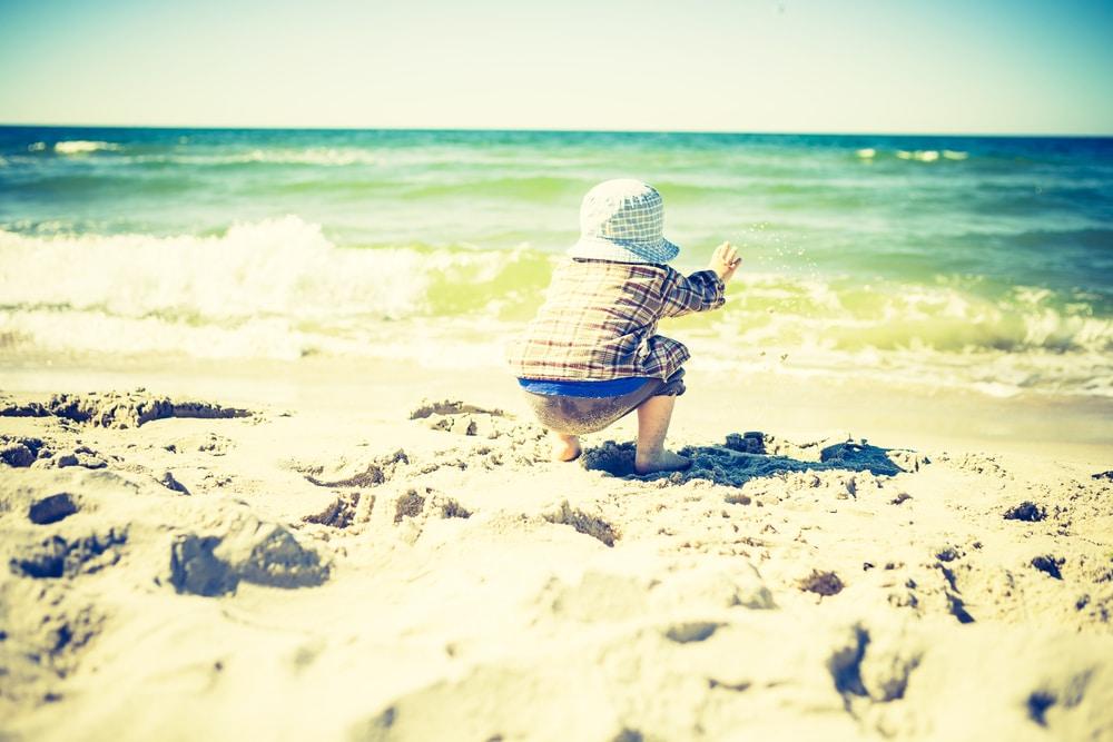 kid on beach vintage