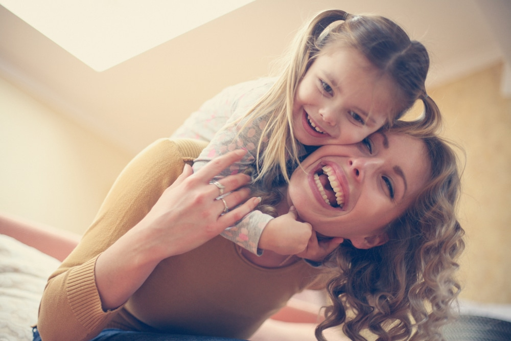 mother and daughter laugh