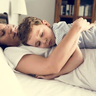 mother sleeping with kid