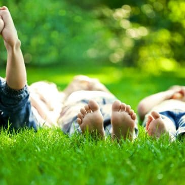 kids lying on grass