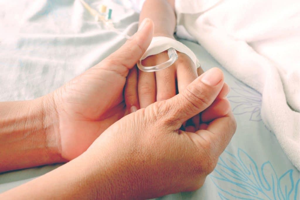kid at hospital hand