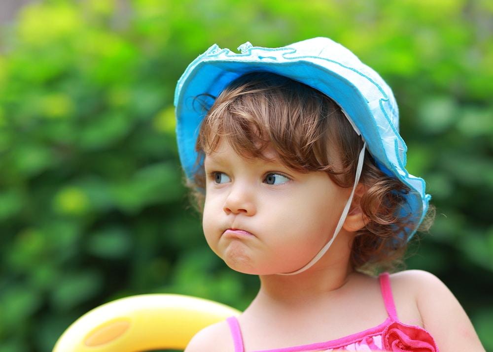 little girl unhappy summer