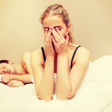 woman crying man sleeping