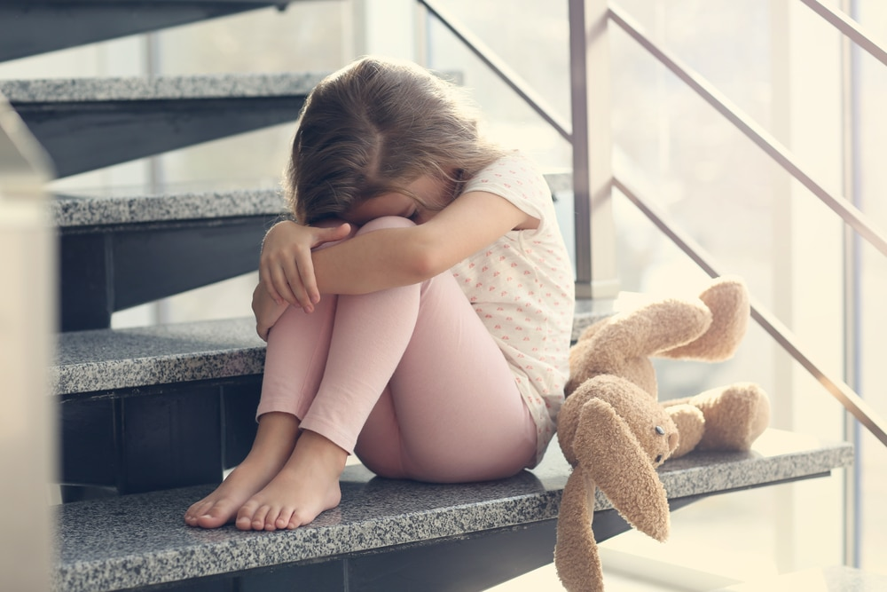 little girl crying on stairs