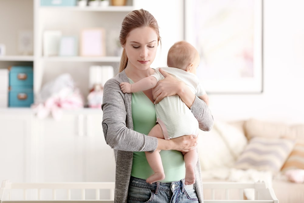 depressed woman with baby