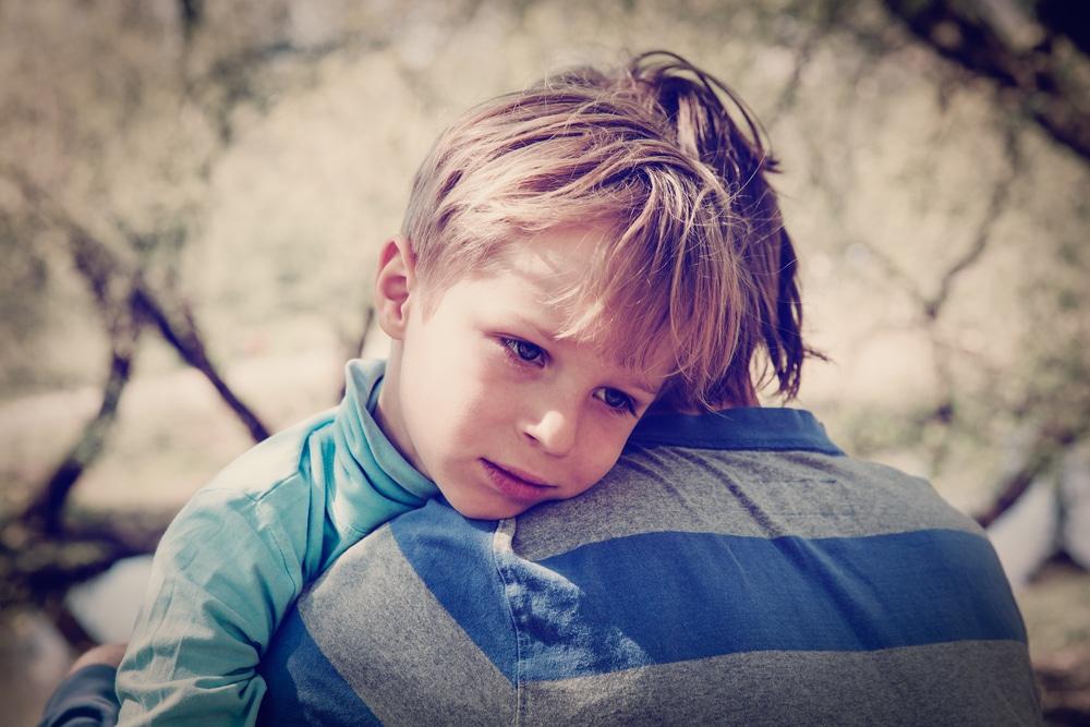 sad boy with father