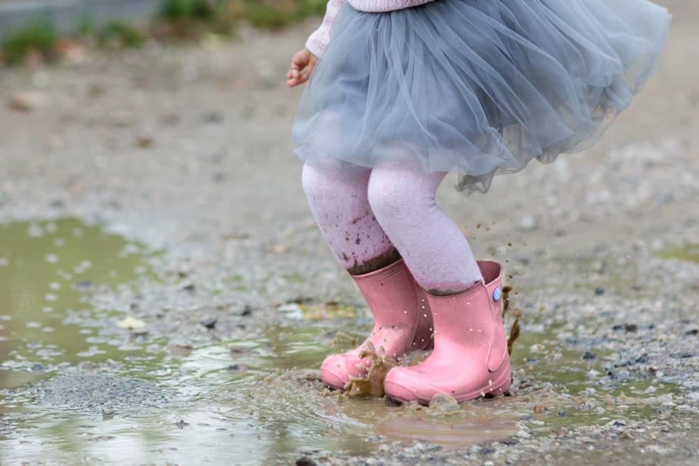 little girl jump in water