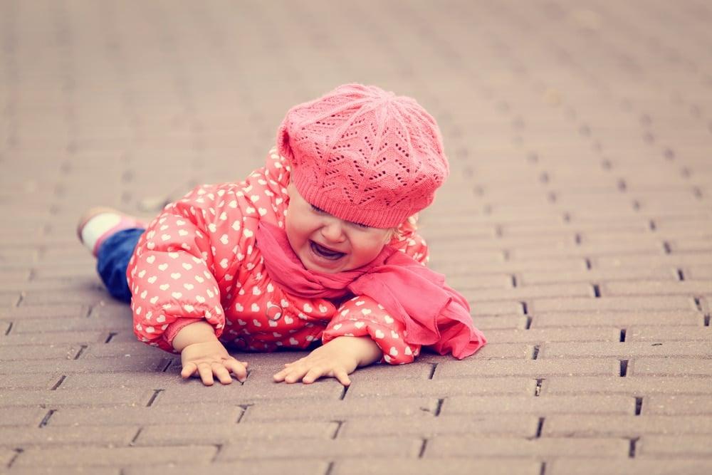 little girl fall crying