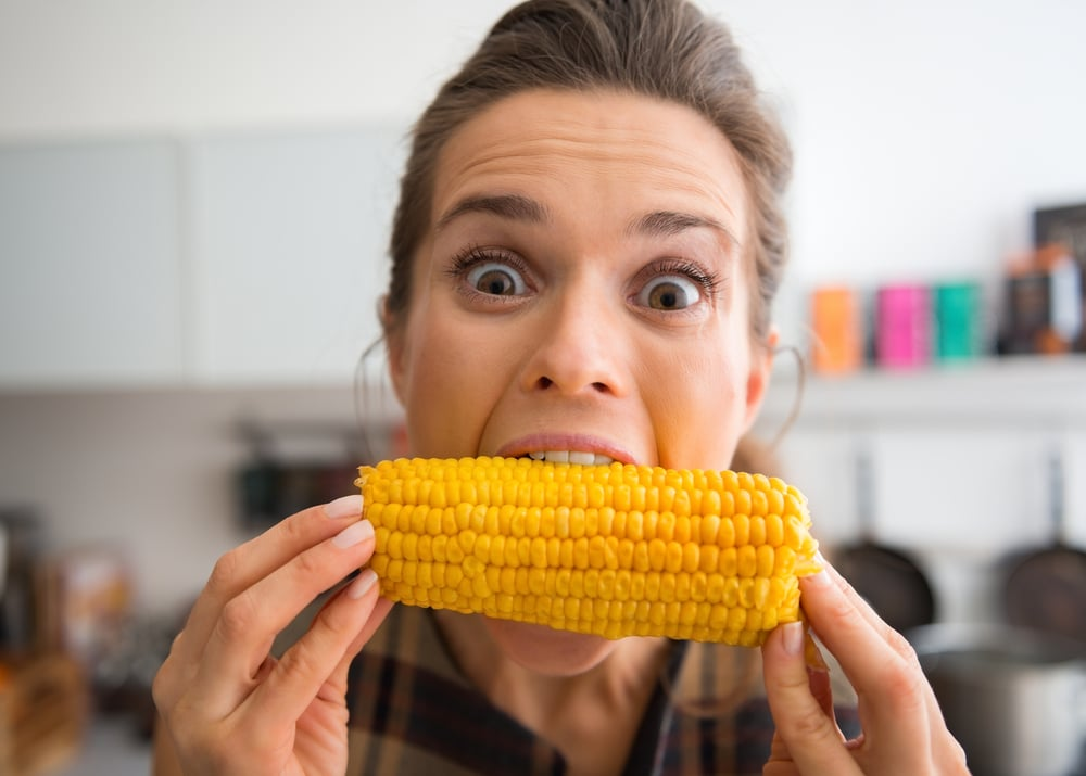 woman eat corn