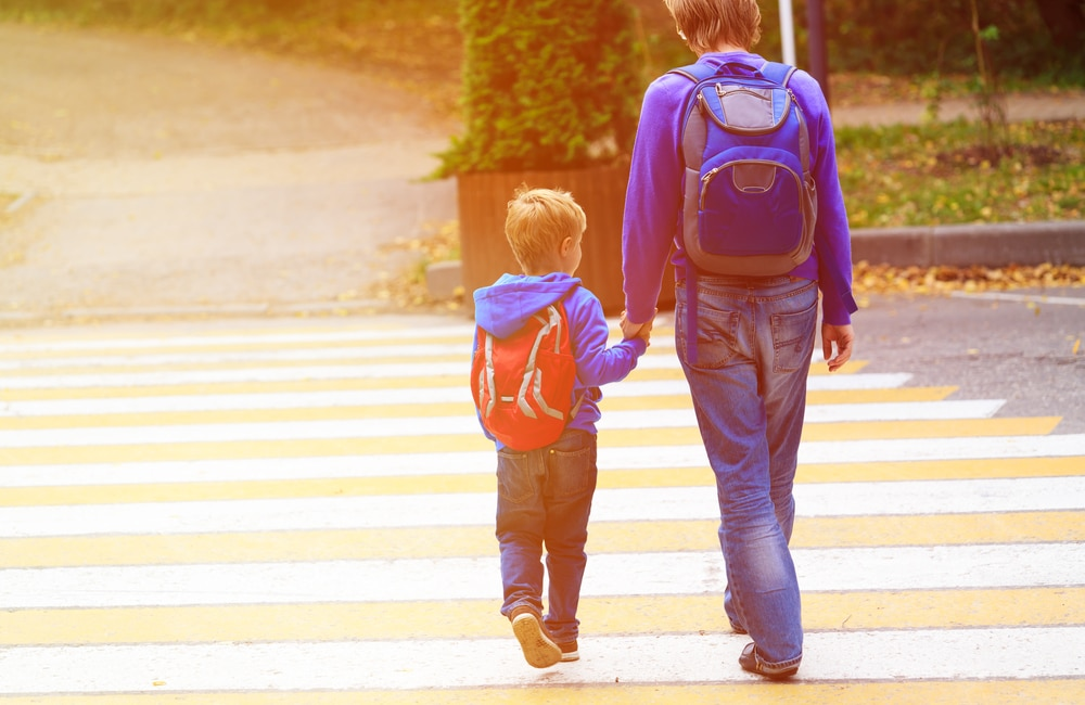 kid going to school with mother