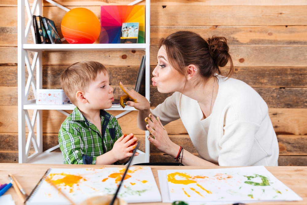 kid and mother painting