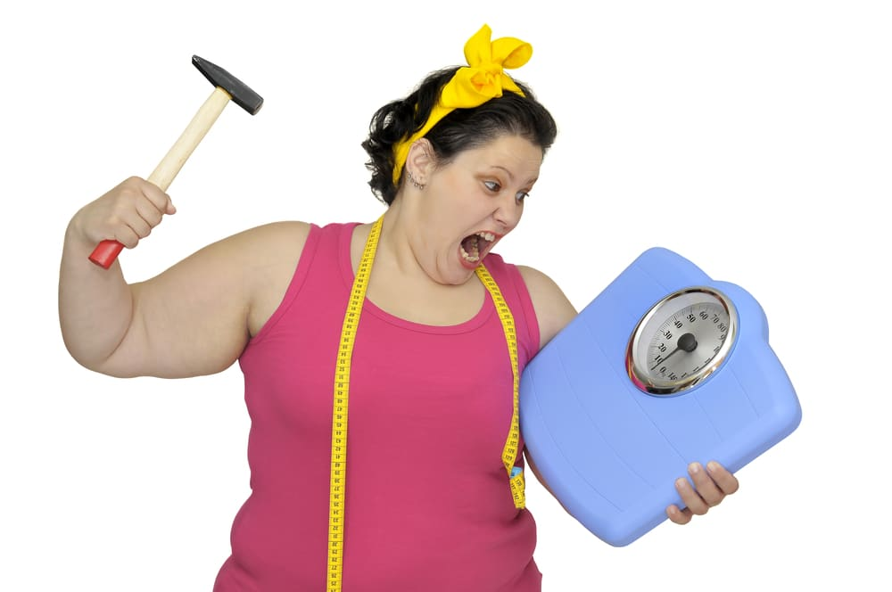 angry woman breaking scale