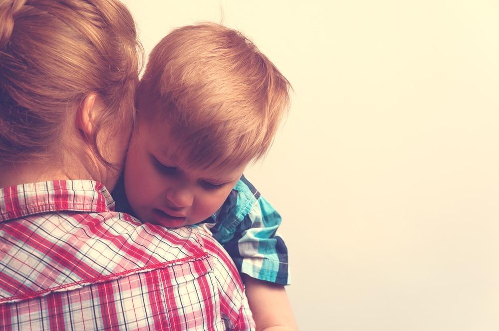 mother and kid hug