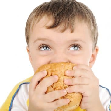 kid eat sandwich