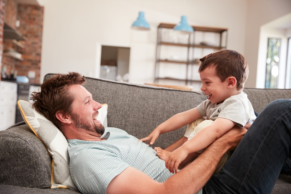 father and son on couch