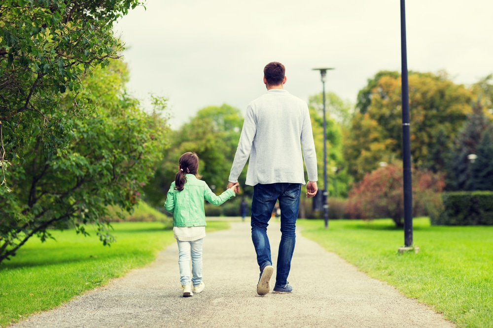 little girl walk away with father