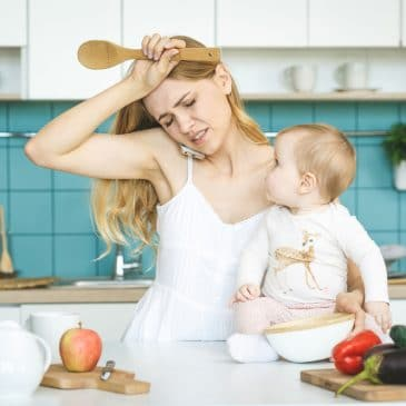 stressed mother in kitchen with baby