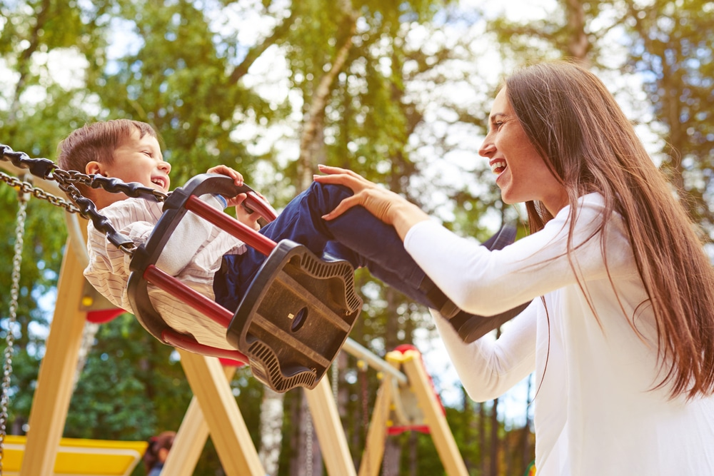 woman and kid at playground
