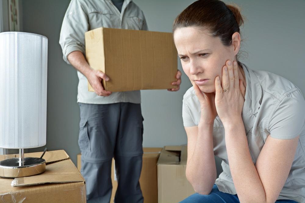unhappy woman man moving