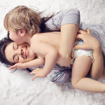 mother and baby hug