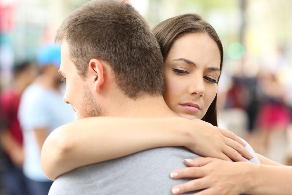 woman embrace man