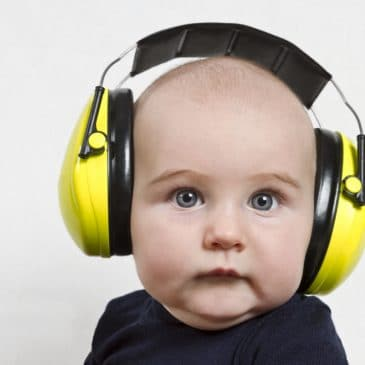 baby with ears protection