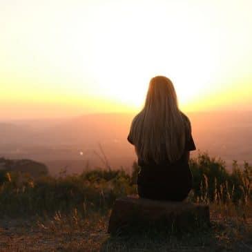 woman alone sunset