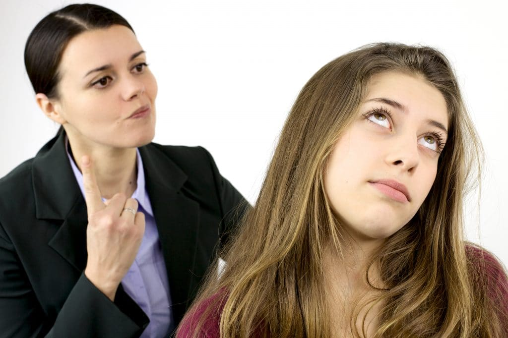 annoyed teenager and her mom