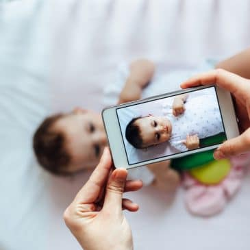 mother take picture of baby