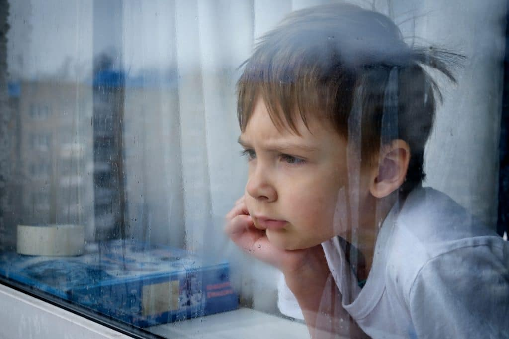 kid waiting in window