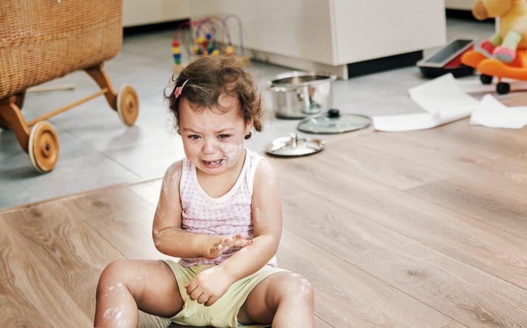 little girl crying on floor