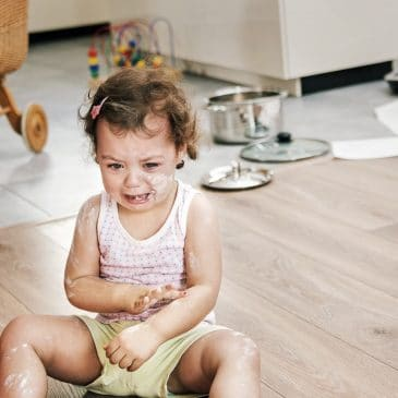 little girl crying on floor